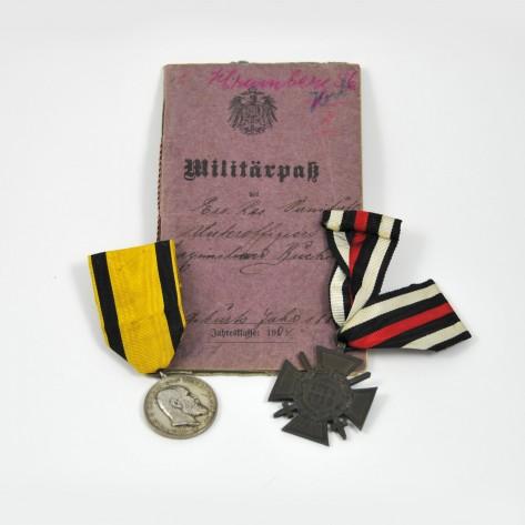 Dos condecoraciones y Militärpass