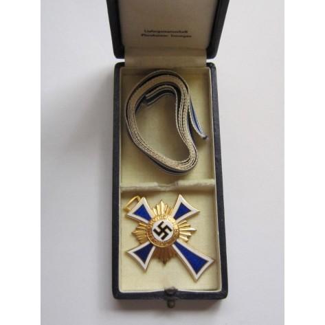 Cruz de las Madres en oro.